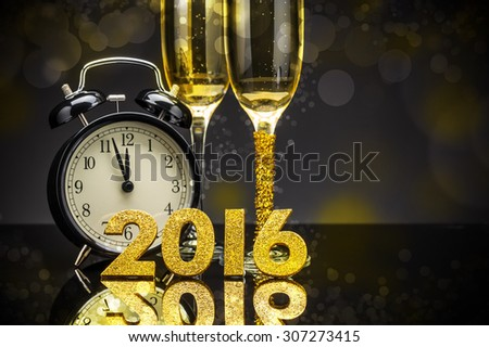 Celebration theme with champagne and clock - stock photo
