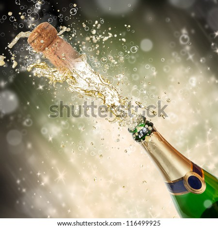 Celebration theme with splashing champagne - stock photo