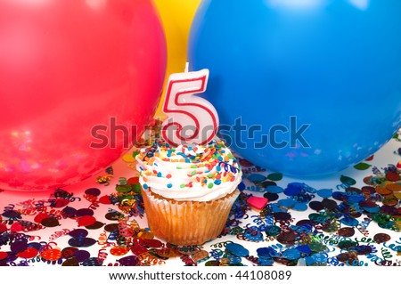 Celebration with balloons, confetti, cupcake, and number 5 candle.