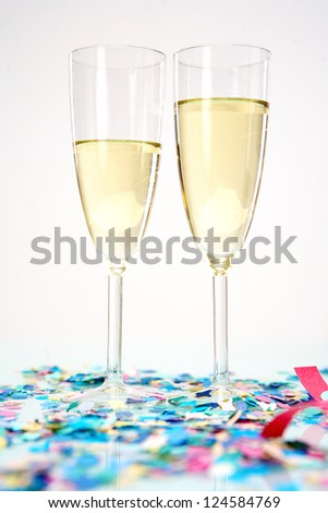 Celebration with two wine glasses and confetti