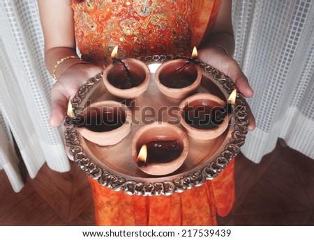 Celebrations of Deepawali by illuminating Diyas. - stock photo