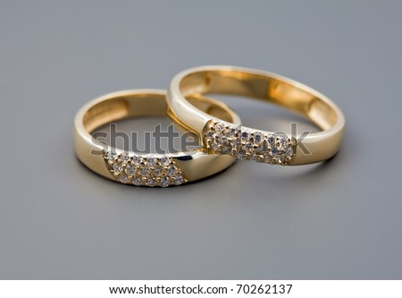 Celebratory accessories - two rings for wedding day and card - stock photo