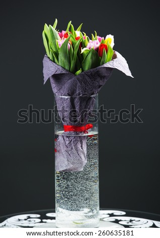 Celebratory bouquet of spring flowers in a vase - stock photo