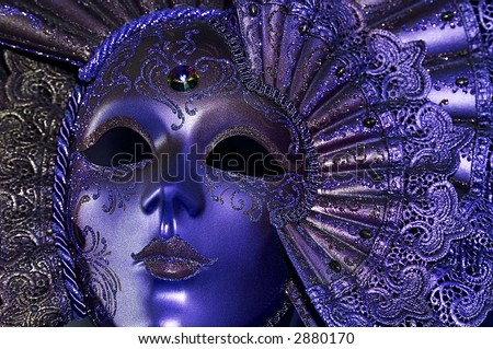 Celebratory dark blue mask with a jewel - stock photo
