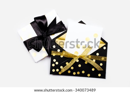 Celebratory envelope with a blank card and present - stock photo