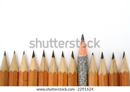 Celebratory pencil among usual pencils from bottom - stock photo
