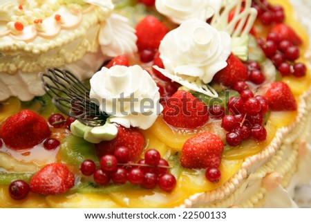 Celebratory pie decorated with fruit and berries