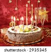 celebratory table (cake and candles, two glasses with champagne, gift boxes) on red - stock photo