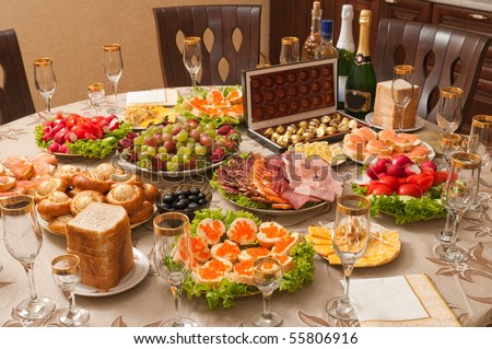 Celebratory table layout for a small family feast. - stock photo