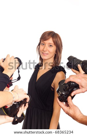 Celebrity Woman in front of Paparazzi - stock photo