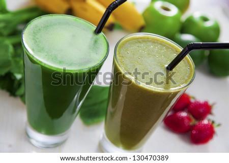 Celery and banana & strawberry juice - stock photo