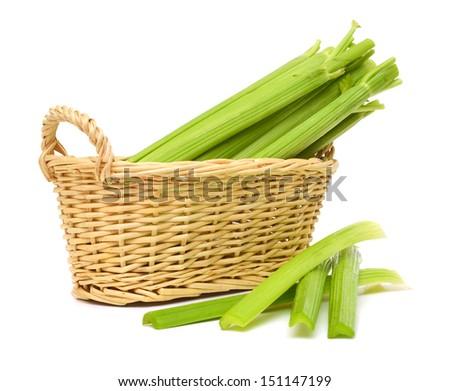 celery sticks isolated in basket on white background  - stock photo