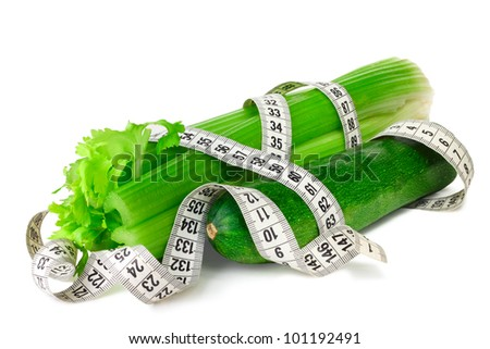 Celery zucchini squash and measure tape diet concept isolated on white - stock photo