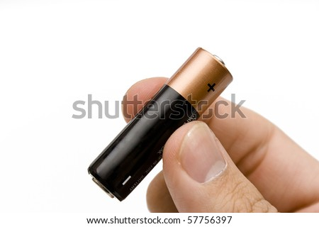 Cell battery held by a male hand. Isolated on white background. - stock photo