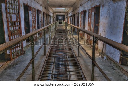 Cell Block in Eastern State Penitentiary with Tracks Used for Serving Meals in Eastern State Penitentiary, Philadelphia, Pennsylvania - stock photo