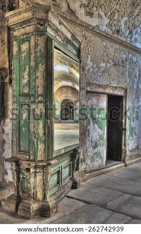Cell Block Reflected in a Mirror at Eastern State Penitentiary, Philadelphia, Pennsylvania - stock photo
