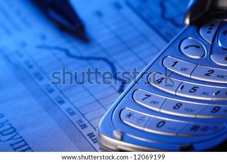 cell phone and chart - stock photo