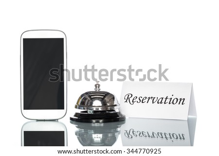cell phone and Service bell on white background, reserved - stock photo