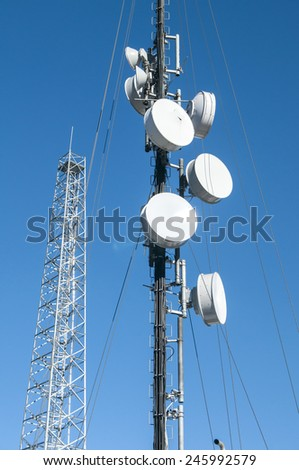 Cell phone antenna or aerial tower used for GSM and UMTS mobile phone transmissions - stock photo