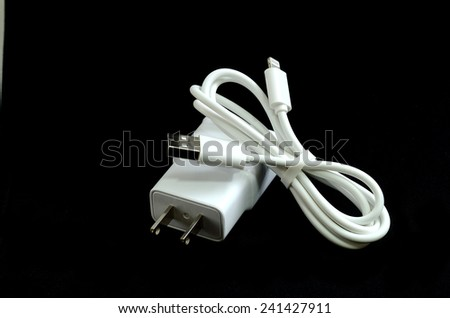 Cell phone charger isolate on black - stock photo