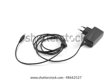 Cell phone charger on white background. - stock photo