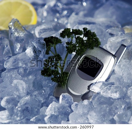 Cell phone on ice - stock photo