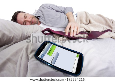 cell phone screen showing text messages while male is in bed - stock photo
