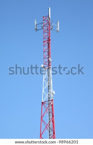 Cell phone tower against a blue sky - stock photo