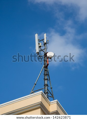 Cell Phone Tower against Blue Sky - stock photo