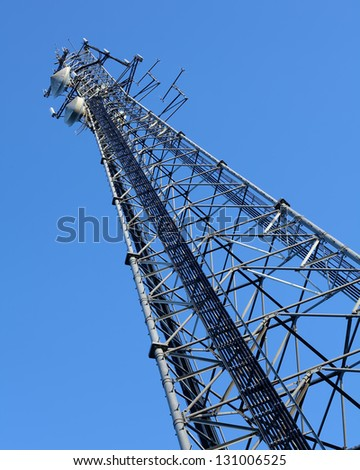 Cell phone  tower and radio antenna - stock photo