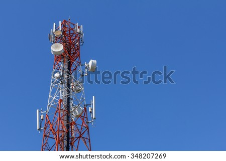 Cell phone tower. Radio tower. Antenna tower. Mobile phone telecommunication radio antenna tower. Wireless communication tower. Transmission towers phone. Tower in blue sky background. - stock photo