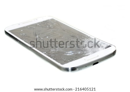 Cell phone with a broken screen  isolated on white - stock photo