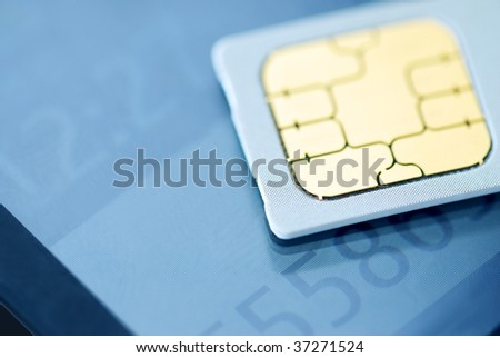 Cell phone with SIM card,Closeup. - stock photo