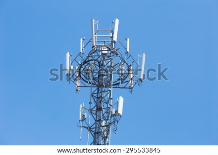 Cell site, Telecommunications radio tower or mobile phone base station with blue sky background - stock photo