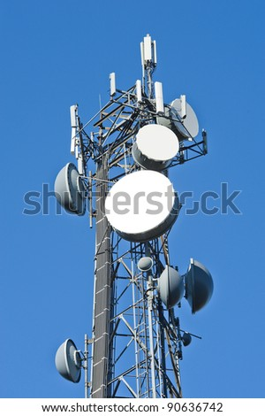 Cell tower and radio antenna - stock photo
