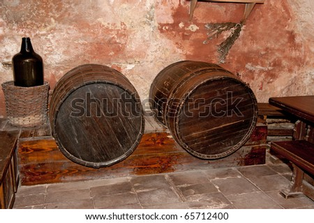 Cellar with casks. An old basement with wine casks - stock photo