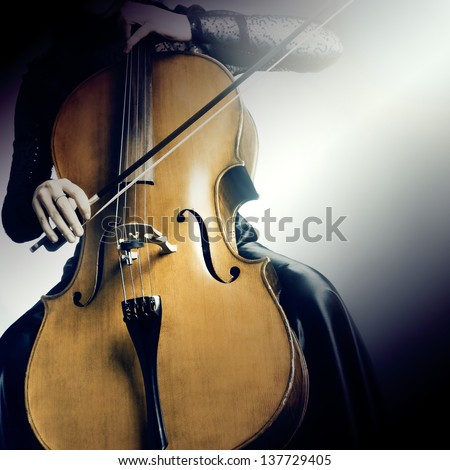 Cello musical instrument cellist musician playing. Woman with cello - stock photo