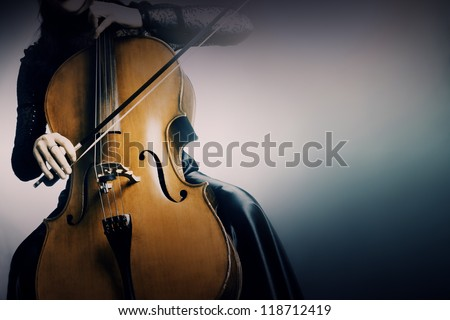 Cello orchestra musical instrument playing cellist musician - stock photo