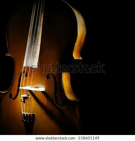 Cello orchestra musical instruments closeup on black - stock photo