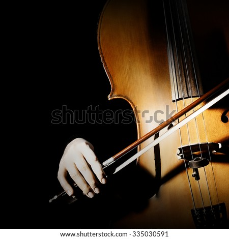 Cello player cellist playing music instrument hands closeup. Orchestra instruments isolated - stock photo
