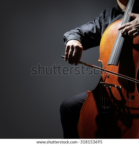 Cello player or cellist performing in an orchestra isolated with copy space - stock photo