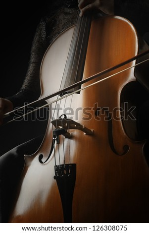 Cello playing cellist classical orchestra musical instrument - stock photo
