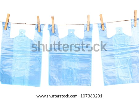 Cellophane bags hanging on rope isolated on white - stock photo