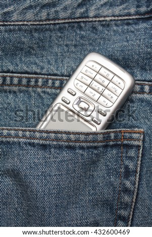 Cellphone in jeans pocket - stock photo