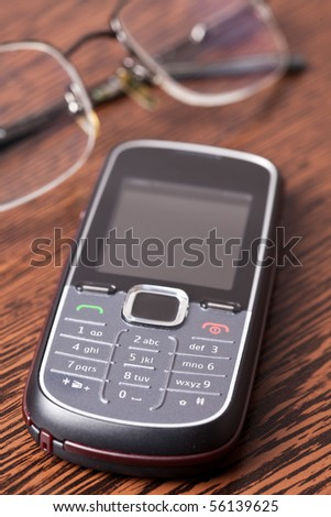 cellphone on wooden table