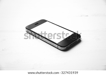 cellphone over white table black and white color style - stock photo