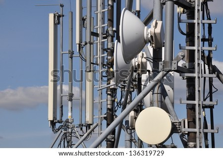 Cellular communications system on a steel tower - stock photo