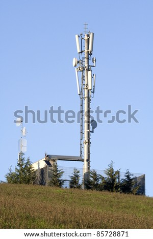 Cellular network: mobile telephony radio tower (fixed-location transceiver known as a cell site or base station). - stock photo