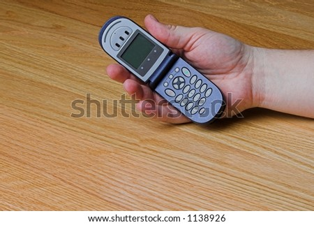 cellular phone in palm of hand - stock photo