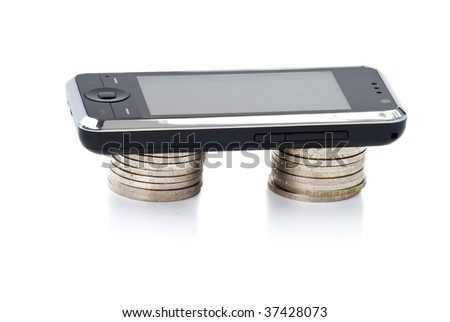 Cellular phone lays on stacks of coins. Concept e-commerce and payment for communication. Isolated on white background. - stock photo